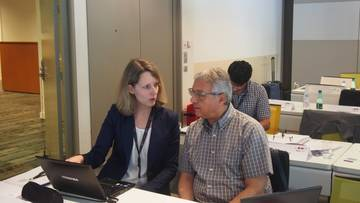 Verena Peuser, Research and Innovation Manager at Eurice discussing project details with Prof. Mondher Bouzayen.
